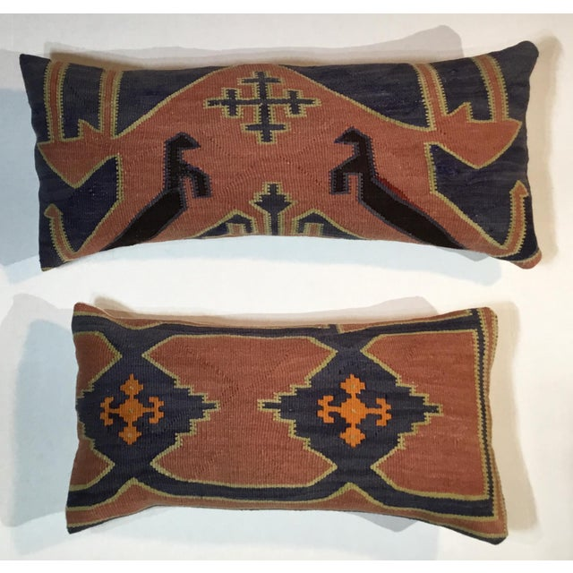 Exceptional pair of pillows made of handwoven flat-weave antique Kazak rug fragment, beautiful geometric motifs with...