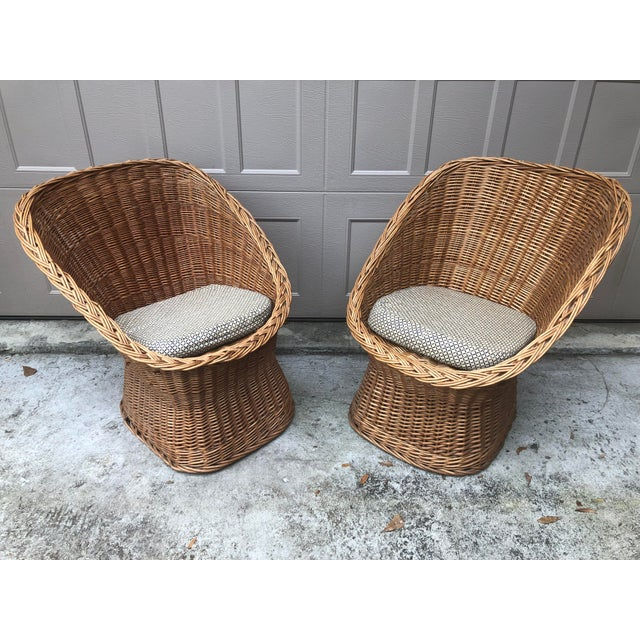 Comfortable scoop Wicker chairs from the early 1960's. Made in Yugoslavia label on bottom of each chair. Comes with seat...