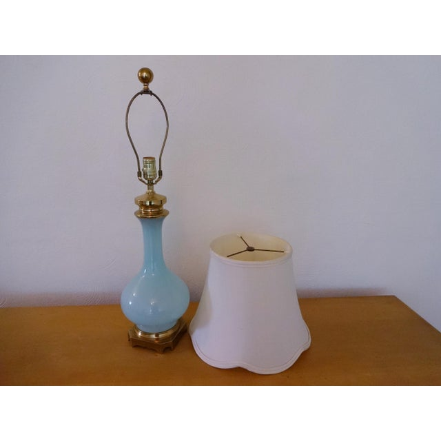 Impressive vintage lamp, by Paul Hanson. Made from solid brass and extremely thick opaline glass; This monumental lamp is...