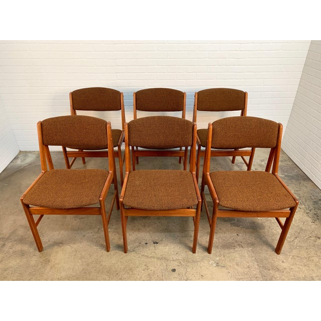 Set of six teak dining chairs by Artfurn company of Denmark with sculptural v-shaped frames.