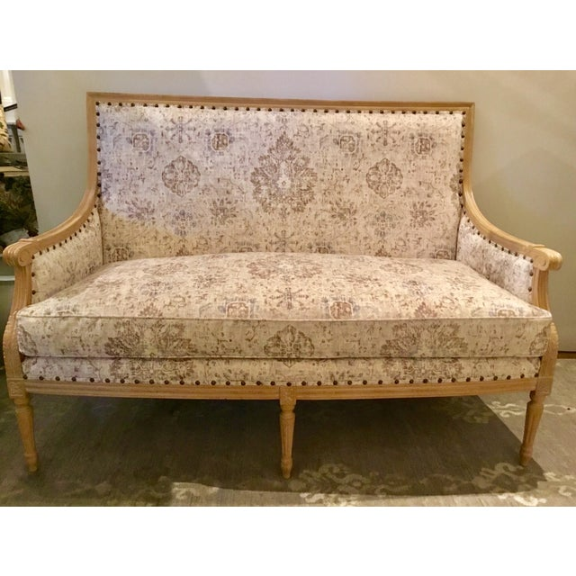 Stylish Currey & Co. Transitional Lancaster Settee, elegabt French style frame with fluted legs, off-white, brown, and...