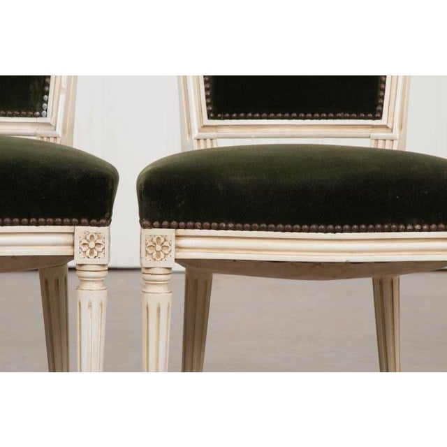 This charming pair of vintage Louis XVI cream-painted side chairs, c.1970's, were found in France and are presented in...