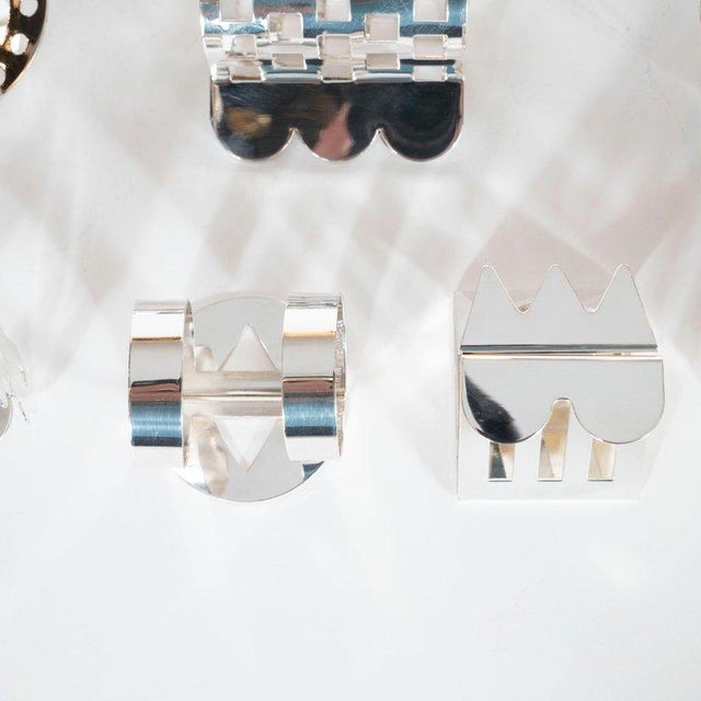 This set of 11 silver plate napkin rings was designed by Nathalie du Pasquier for Bodum, circa 1980. Pasquier, an...