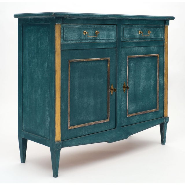 A French Directoire style teal antique buffet featuring two dovetailed drawers above two doors with original gilt brass...