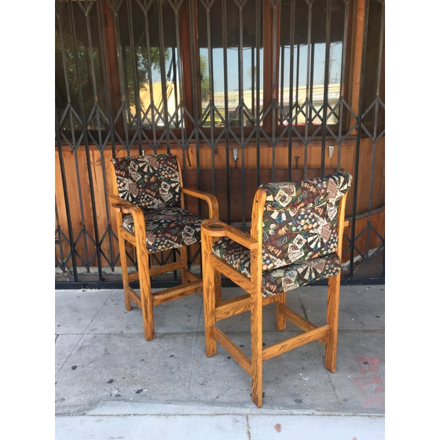 Pair of mid century barstools with a casino upholstery print, can be used indoors and outdoors.