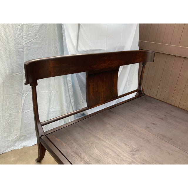 Modern Klismos style queen bed. The bed is made of alder with a rich deep walnut stain. The bed is a platform style bed....