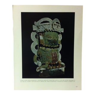 """Circa 1960 """"Jade Death Mask With Shell Eyes and Obsidian Pupils"""" Treasures of Ancient America Mounted Print For Sale"""