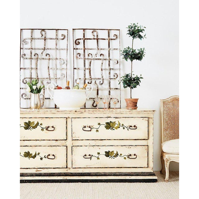 Rustic country Italian farmhouse four drawer commode, chest of drawers, or sideboard. Features a lacquer painted finish...