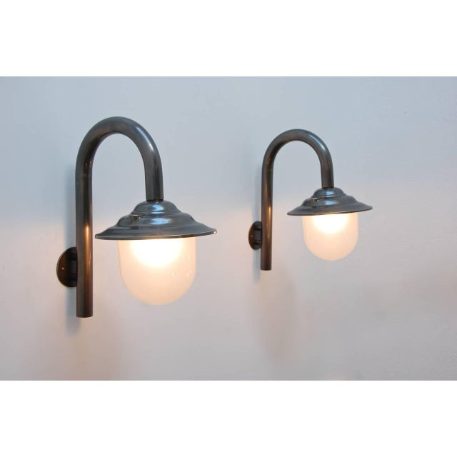 Elegant majestic cast bronze exterior wall fixtures from Italy.