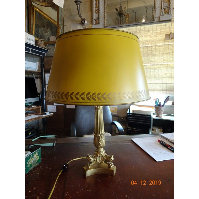 Beautiful bronze dore bouillotte lamps with a yellow / mustard color tole shade with flower pattern on the trim. Two...