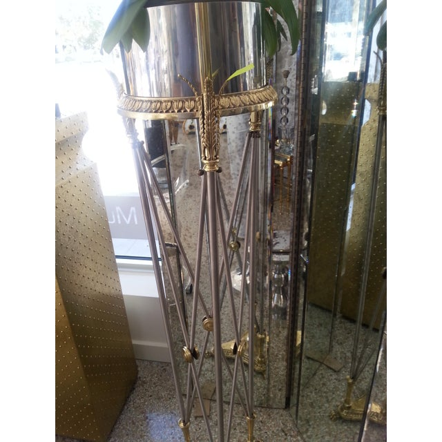 Maison Jansen jardinière pedestal in stainless steel and brass with high-quality chasework. NOTE - WE CAN ASSIST WITH...