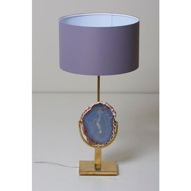 Stunning pair of huge brass and agate stone table lamps attributed to Willy Daro. The table lamps are in very good...