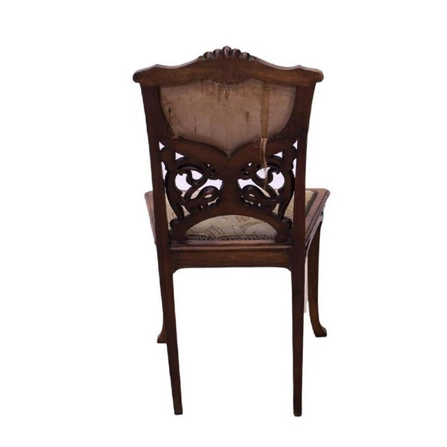 Beautiful example of fine French Art Nouveau craftsmanship! French Art Nouveau intricately carved oak side chair...