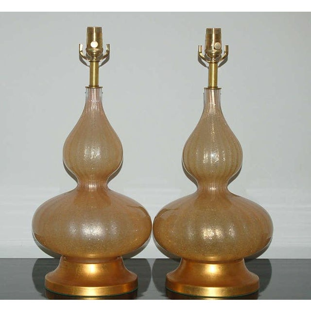 Curvaceous vintage Murano glass eglomise table lamps in CHAMPAGNE on gold leafed base. These are very elegant and sexy....