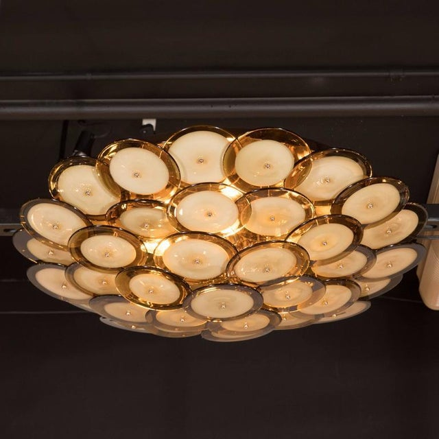 This handblown Murano chandelier is composed of an abundance of overlapping disks with smoked topaz perimeters and opaque...