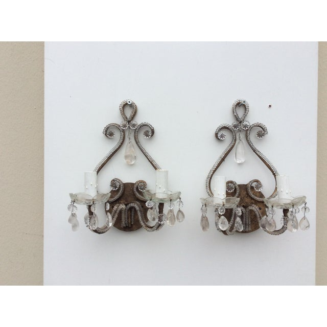 Nice looking pair of vintage rock Crystal Sconces with beaded surfaces . Each Sconce has two lights and the back...