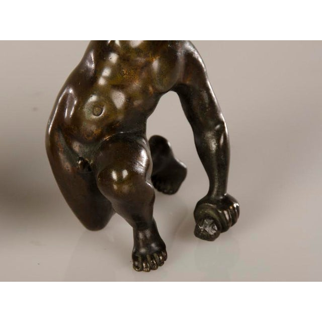 A pair of cast bronze candlesticks each featuring a kneeling putto from Italy c.1880 - Image 6 of 7