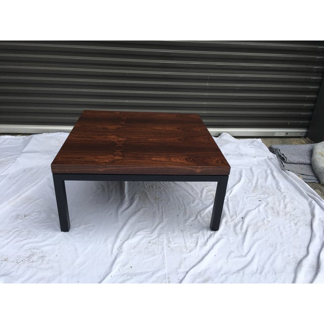 Authentic Mid-Century coffee table, attributed to Milo Baughman. Rosewood veneer top on an ebonized wooden base. Partial,...