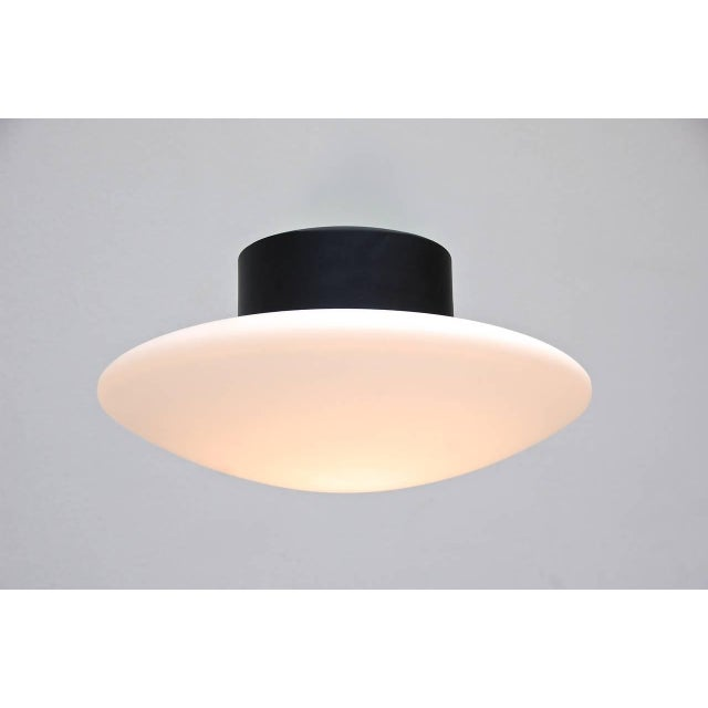 Amazing distinct large flush mount lamp from Italy attributed to Arteluce from the 1950s. One medium based bulb in each...