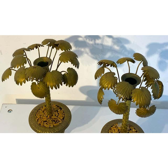 Pair of Regency style bronze Palmette urn candlesticks, each one of topiary form, realistically cast and modeled, with...