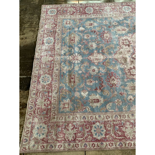 Worn red and blue geometric patterned Tabriz Persian rug. Vintage fade adds depth and character to this detailed piece.