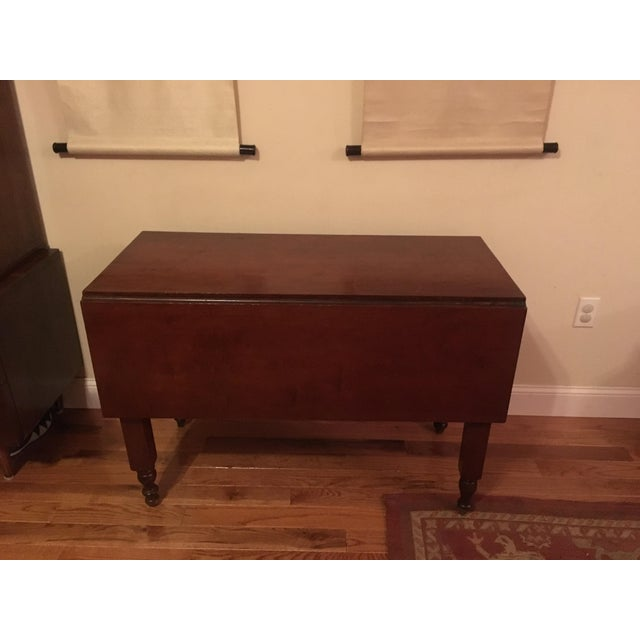 Antique cherry table in good condition - has two folding leaves. Can be used for dinner table or entry table. Very...