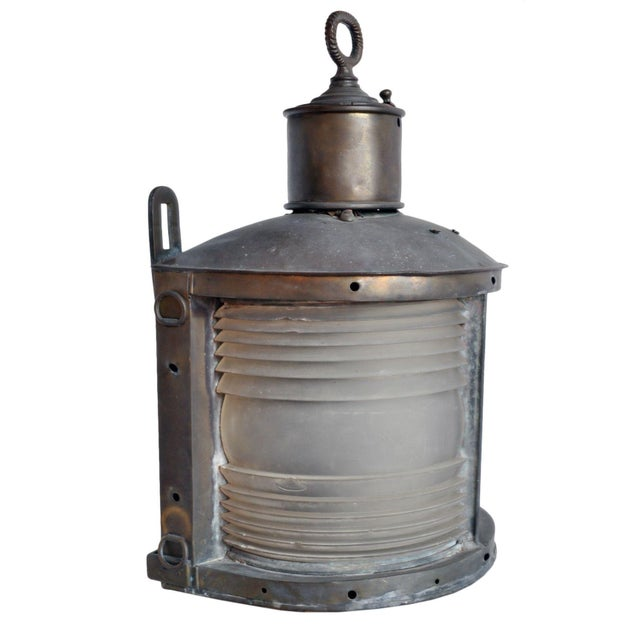 A vintage marine ship light that has aged over time. A wonderful piece to add to your collection or decor. Perfect for a...