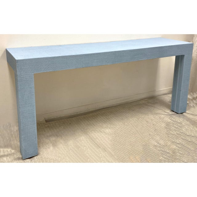This is a 1970s wall mounted grasscloth Parsons style console table. It is in very good condition and there are two if you...