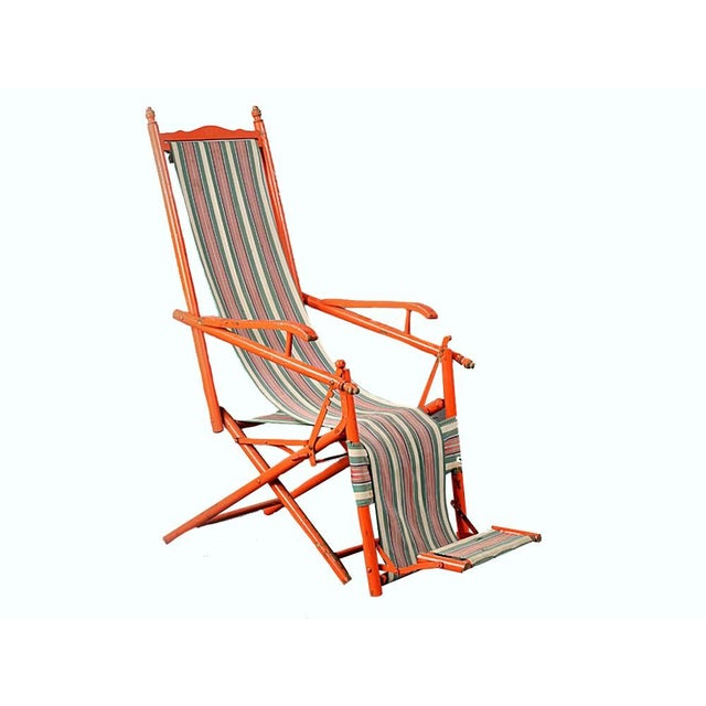 1940s French outdoor recliner with original orange paint and upholstery. Orange paint chipped off on some spots on...