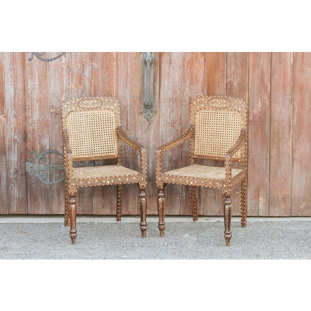 Exquisite inlay chairs with a rounded back and arms. With a hand rubbed brown finish and a cane back and seat these chairs...