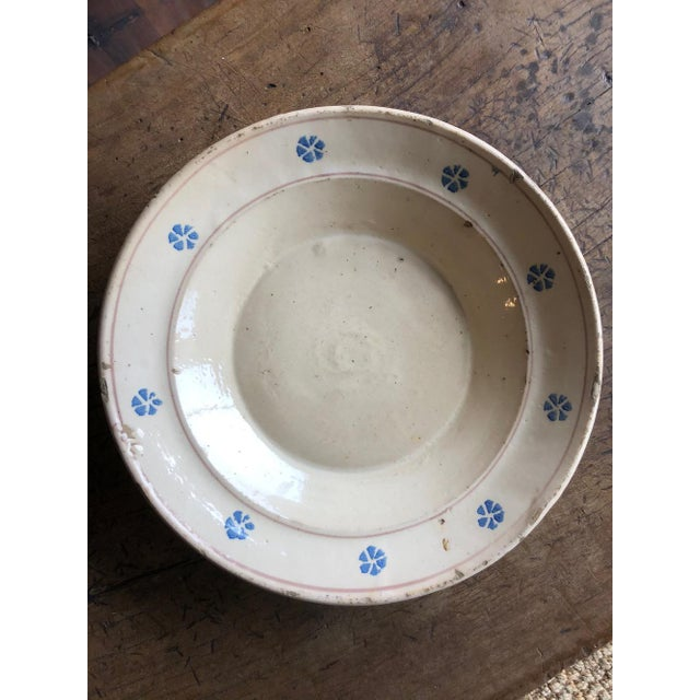 This hand painted ceramic Italian antique terracotta bowl is from the region of Puglia, Italy. The simple blue floral...