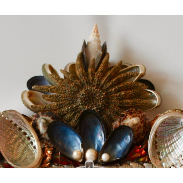 "Elegant Organic Baroque Seashell Frame for a 5 by 7"" photo. This frame features 18-legged Starfish, petroleum blue..."