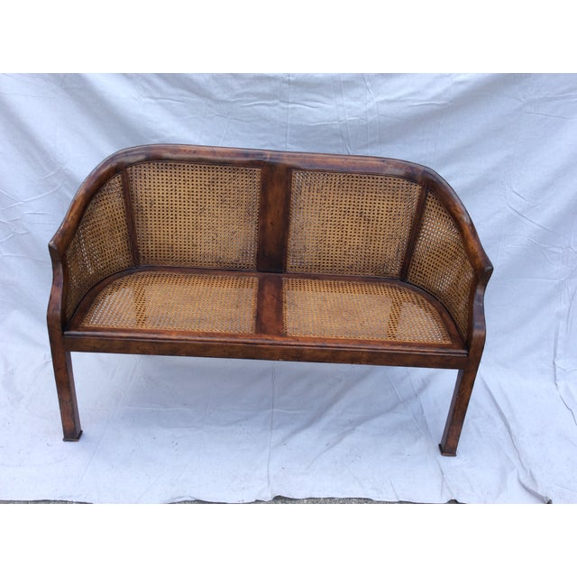 A beautiful mahogany and cane settee with a tan mohair cushion that is foam wrapped in down. I honestly do not know if...