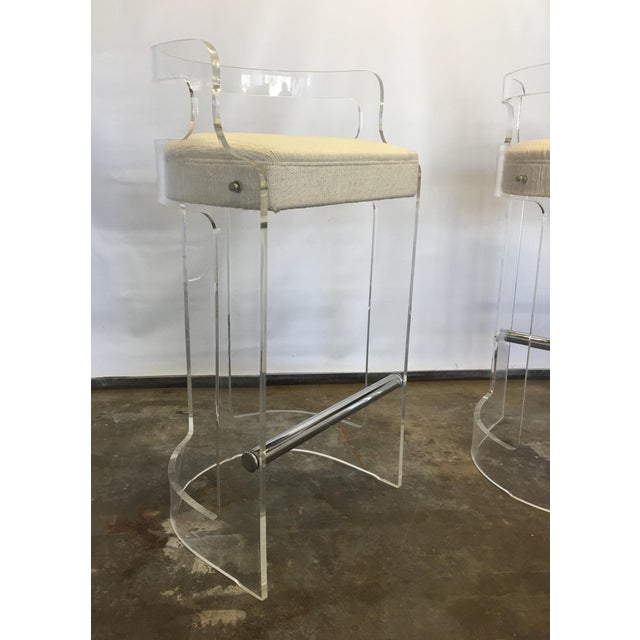 A pair of lucite barrel shaped bar stools made by Hill manufacturing and designed by Charles Hollis Jones. They measures...