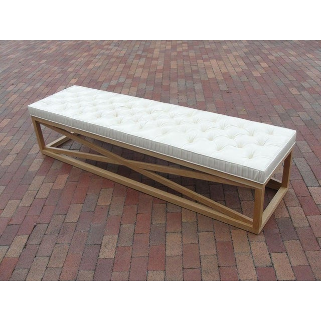 This is a very elegant and modern extra-long (7 feet) bench on 'X' wood frame base and tufted vinyl top.