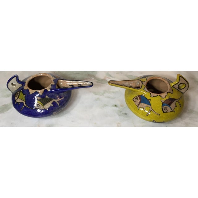 Exceptional pair of ceramic vessel hand painted and glazed with beautiful colorful dish motif all around ,great decorative...