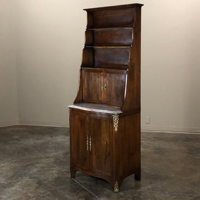 19th Century Country French Walnut Cabinet is an intriguing design, ideal for high traffic areas or cozy spots, while...