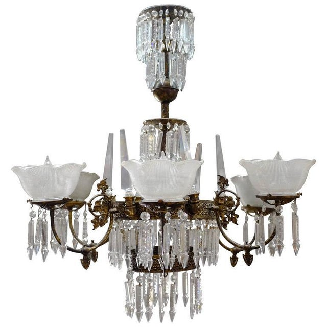 Romanesque style Six-light electric chandelier featuring a mix of hang crystal and handkerchief shade shades, circa 1980....