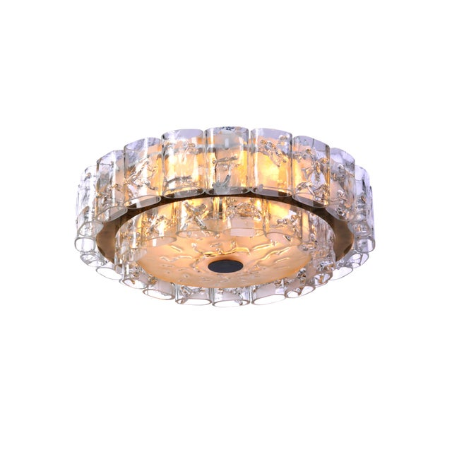 This exceptional 1960's Mid-Century Modernist flush mount was designed by Doria. It features a circular form with two-...