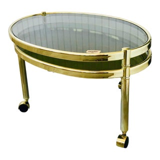 1970s Hollywood Regency Brass Swiveling Nesting Coffee Table For Sale