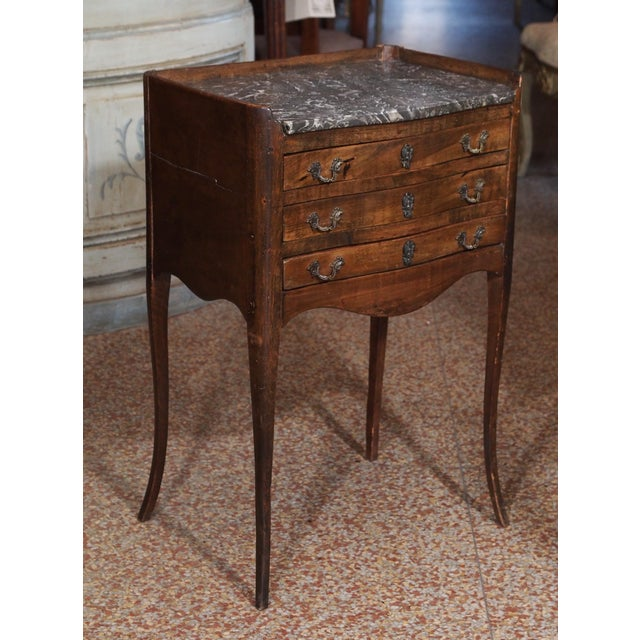 early 19th century bow front walnut side table, gray and white marble top ,three drawers on cabriole legs. (no key)....