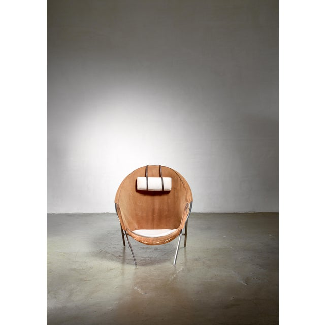 A model BO 360 lounge chair by Danish designer Erik Ole Jørgensen (1925–2002). The chair has a steel frame with a brown...