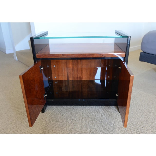 Gorgeous Hawaiian Koa wood and black lacquer night stand from the Elan Collection by Henredon. The furniture pieces...