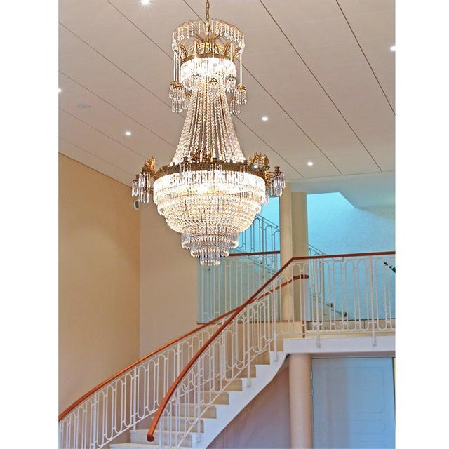 Large light brass colour Empire chandelier with crystal octagons and 12 candle holders A unique and magnificent chandelier...