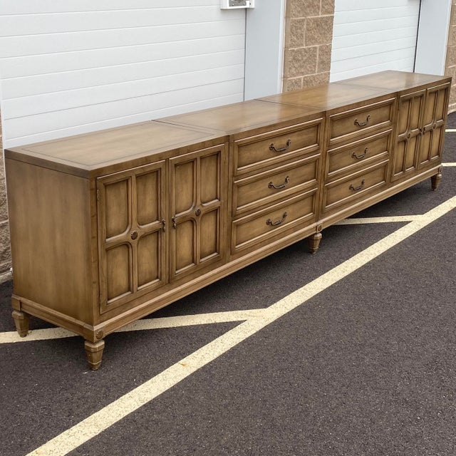 Amazing extra long credenza consisting of two cabinets and two chests of drawers that fit together on a eight legged wood...