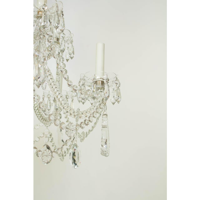 Signed Martinez y Ortz Chandelier, twelve lights, roped crystal arms and large pendalogue crystals. Spain, C. 1980....
