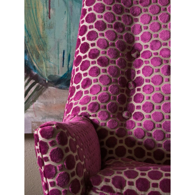 I love how bold this chair acts. The deep saturation of the magenta pattern saturates a room with color with joy and mid-...