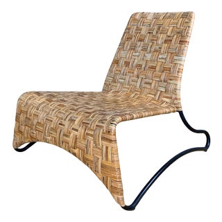 Continental Woven Cane and Blackened Steel Lounge Chair For Sale