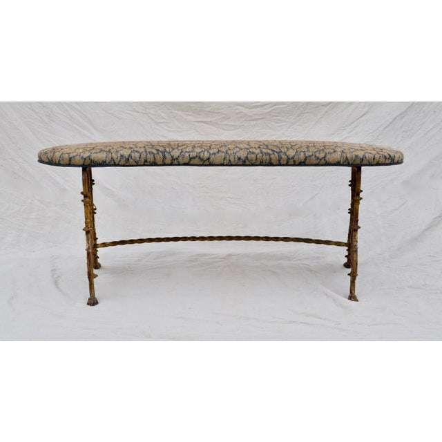 An elegant gold gilt iron bench newly upholstered in plush cotton linen, Indigo blue leopard accented with solid French...