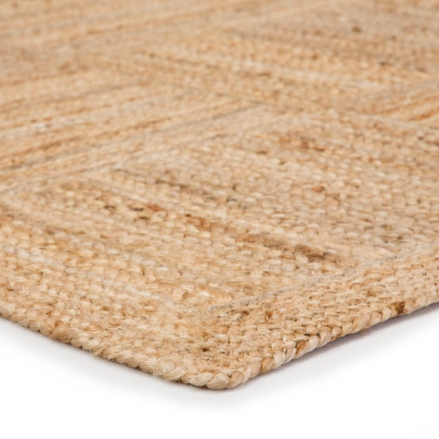 This jute area rug provides a staple to transitional homes with a warm colorway and organic style. A rectangular border...